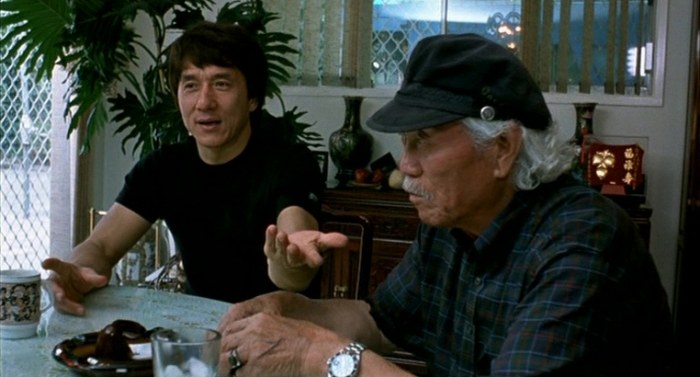 """Fig. 1: Jackie Chan and Papa Chan discuss their family history, around 2002. (Source: """"Traces Of A Dragon"""" DVD, Universum Film)"""