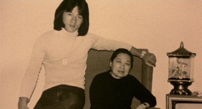 """Fig. 3: A young Jackie Chan with his mother Lily Chan, around 1979. (Source: """"Traces Of A Dragon"""" DVD, Universum Film)"""